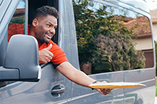 African American Delivery Man Handing Package